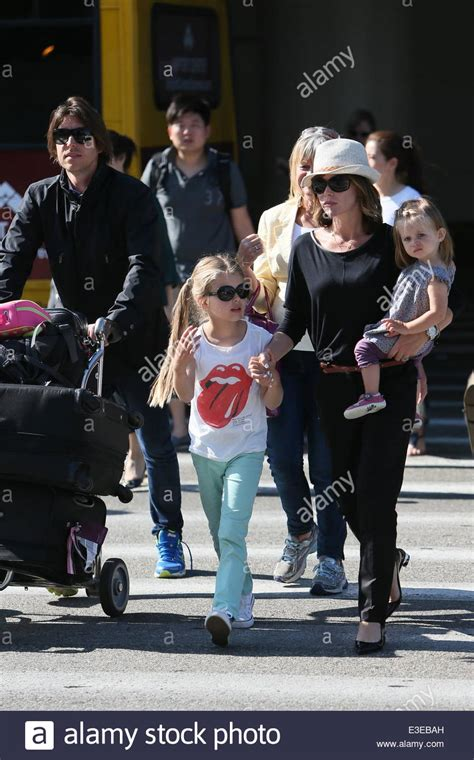 Amanda Holden and husband Chris Hughes with both daughters